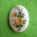 Cameo with yellow flowers