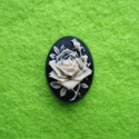Black and white cameo with a rose