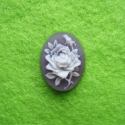 White and purple cameo with a flower